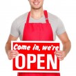 Business shop owner showing open sign - Stock Photo