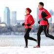 Runners running in winter city — Stock Photo