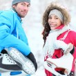 Stock Photo: Ice skating winter couple