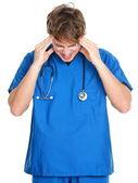 Male Nurse or doctor headache and stress — Stock Photo