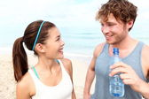 Fitness couple on beach — Stock Photo