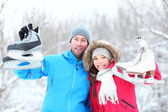 Happy ice skating winter couple — Stock Photo