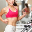 Woman running on treadmill — Stock Photo