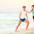 Couple workout training on beach — Stock Photo