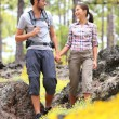 Hiking couple walking in forest — Stock Photo