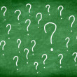 Question mark on green chalkboard or blackboard. - Stock Photo