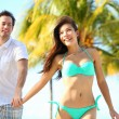 Couple having fun on beach — Stock Photo #22923524