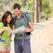 Hiking - hikers looking at map - Stock Photo