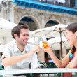 Foto Stock: Cafe couple drinking