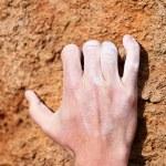 Climbing hand grip on rock — Stock Photo