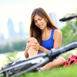 Knee pain bike injury woman - Stock Photo