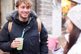 Friends in city drinking bubble tea — Stock Photo