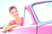 Woman driving vintage car — Stock Photo