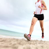 Running legs and shoes — Stock Photo