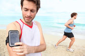 Running workout with music — Stock Photo