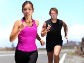 Runners - couple running — Stock Photo