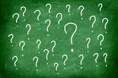 Question mark on green chalkboard or blackboard. — Stock Photo