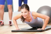 Gym woman working out — Stock Photo