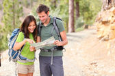 Hiking - hikers looking at map — Stock Photo