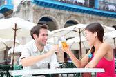 Cafe couple drinking — Stock Photo