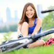Woman going biking on road bike — Stock Photo