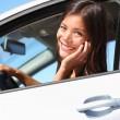Car woman using smart phone — Stock Photo
