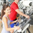 Gym people in fitness center - 