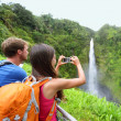 Stock Photo: Tourist couple on Hawaii taking pictures