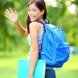 Woman student waving - Stock Photo