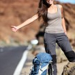Travel hitchhiker woman happy — Stock Photo