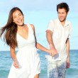 Beach couple walking happy — Stock Photo #24537481
