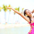 Happy on beach travel - woman in sarong — Stock Photo #24537547
