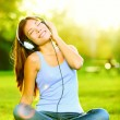 Woman listening to music — ストック写真