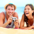 Young happy multicultural couple on beach — Stock Photo #24537595