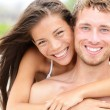 Beach couple - young happy couple portrait - Stock Photo