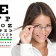 Optometrist or optician with eyewear glasses — Stok fotoğraf