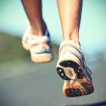 Runnning shoes on runner — Stock Photo