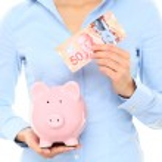 Canadian money saving piggy bank — Stock Photo #24537727