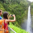 Couple tourists on Hawaii by waterfall — Stock Photo #24537865