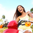 Happy free asian woman on scooter — Stock Photo