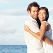 Happy young couple on beach — Stock Photo