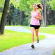 Running woman in park — Stock Photo