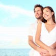 Happy beach couple portrait — Stock Photo #24537983