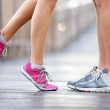 Love sport concept - running couple kissing — Stock Photo