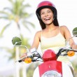 Free woman riding scooter happy — Stockfoto