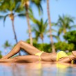 Foto Stock: Beautiful vacation woman relaxing at a spa resort