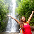 Foto de Stock  : Hawaii womtourist excited by waterfall