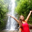 Stock Photo: Hawaii womtourist excited by waterfall