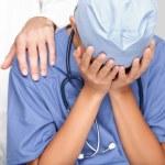 Nurse, doctor upset sad crying — Stock Photo #24538353