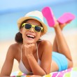 Beach woman laughing fun in summer - Stok fotoğraf